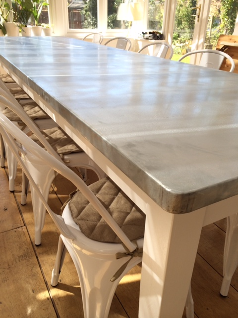 Close up of the rounded corners of a bespoke UKAA zinc table in a customers conservatory