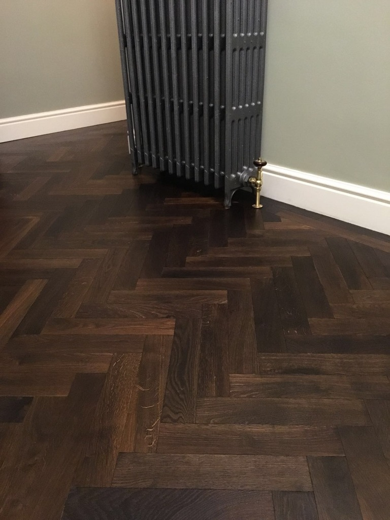 Original antique old recycled parquet flooring fitted in a herringbone design