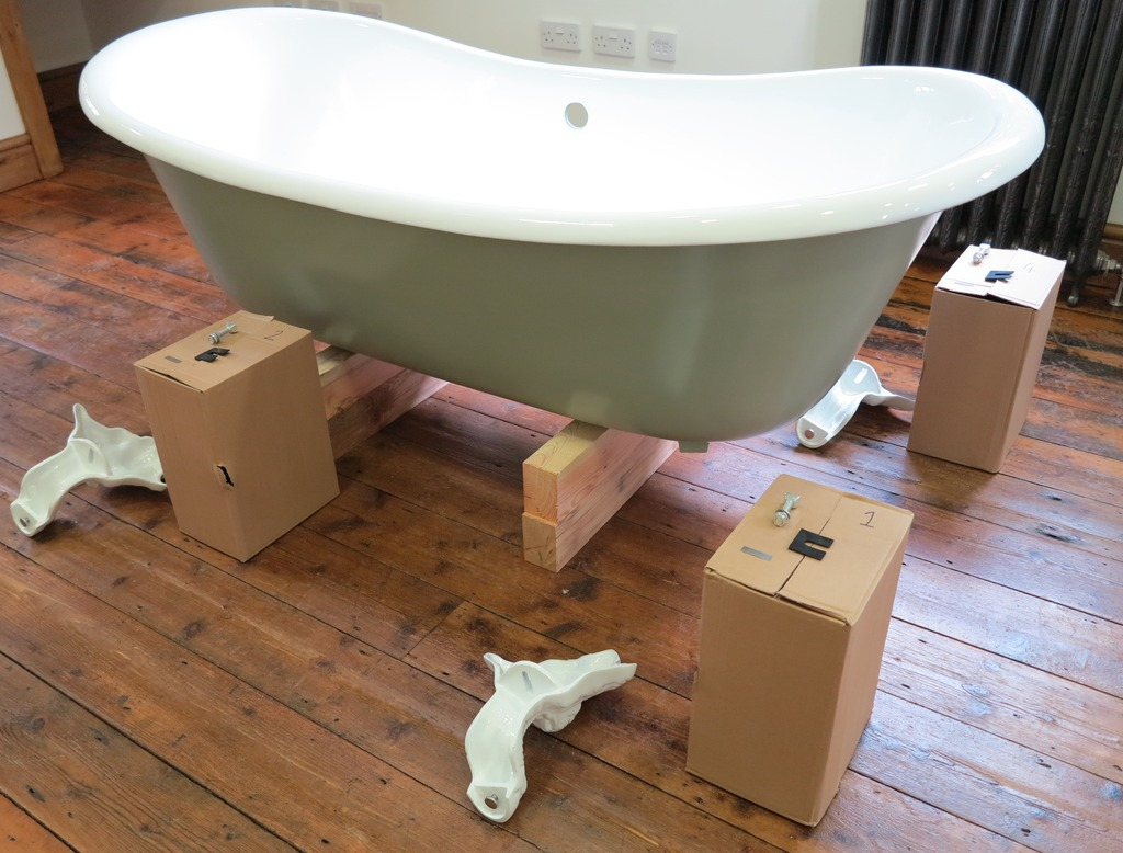 cast iron slipper bathtub and clawfoot ready for installation with new enamel and painted exterior. Vintage metal and iron bath tub free standing.