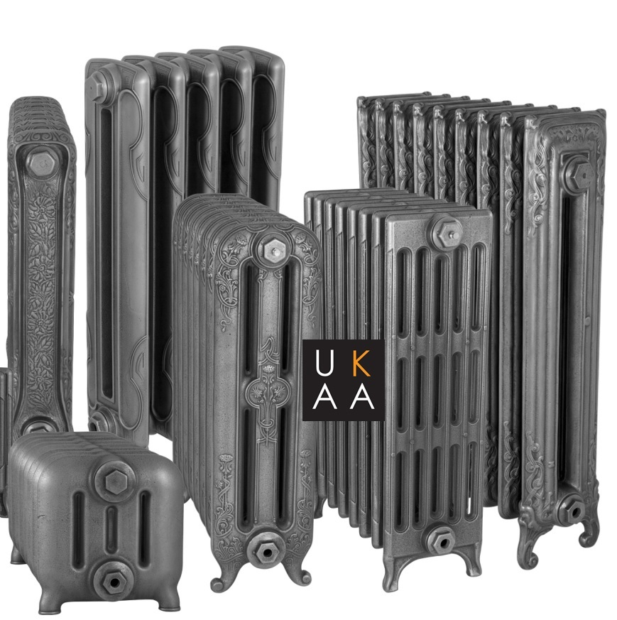 Reproduction old Victorian style decorative and column cast radiators suitable to use as electric radiators in a burnished finish made by Carron