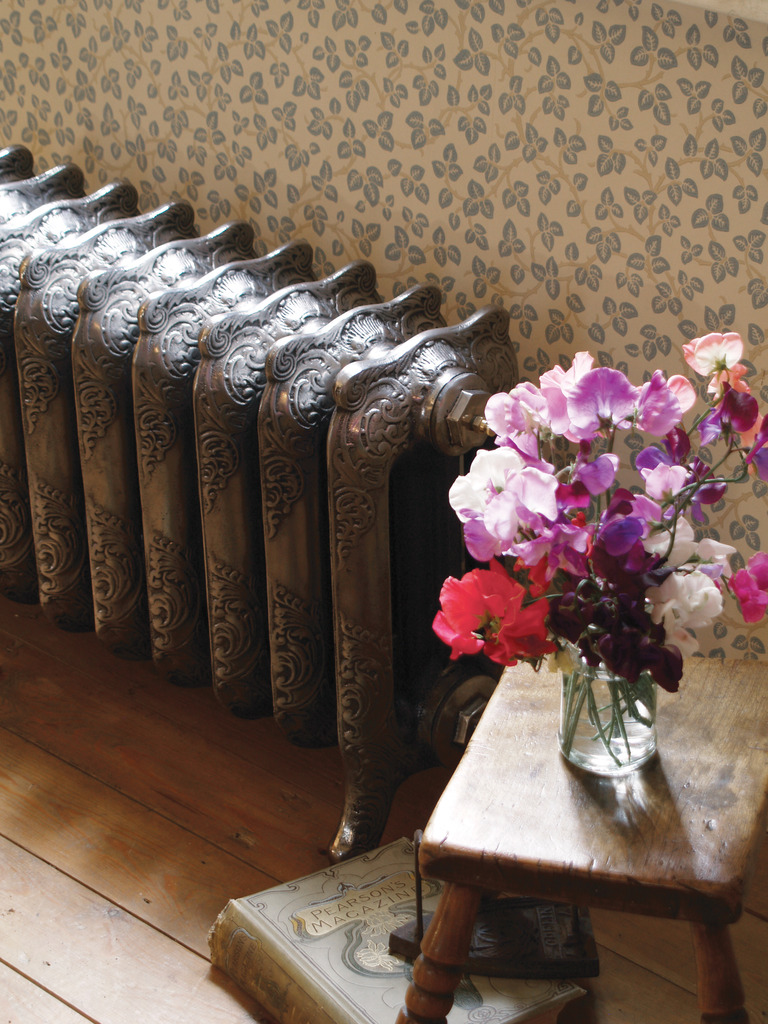 Polished Cast Iron 3 Column Rococo Radiator made by Carron and Sold Worldwide by UKAA title=