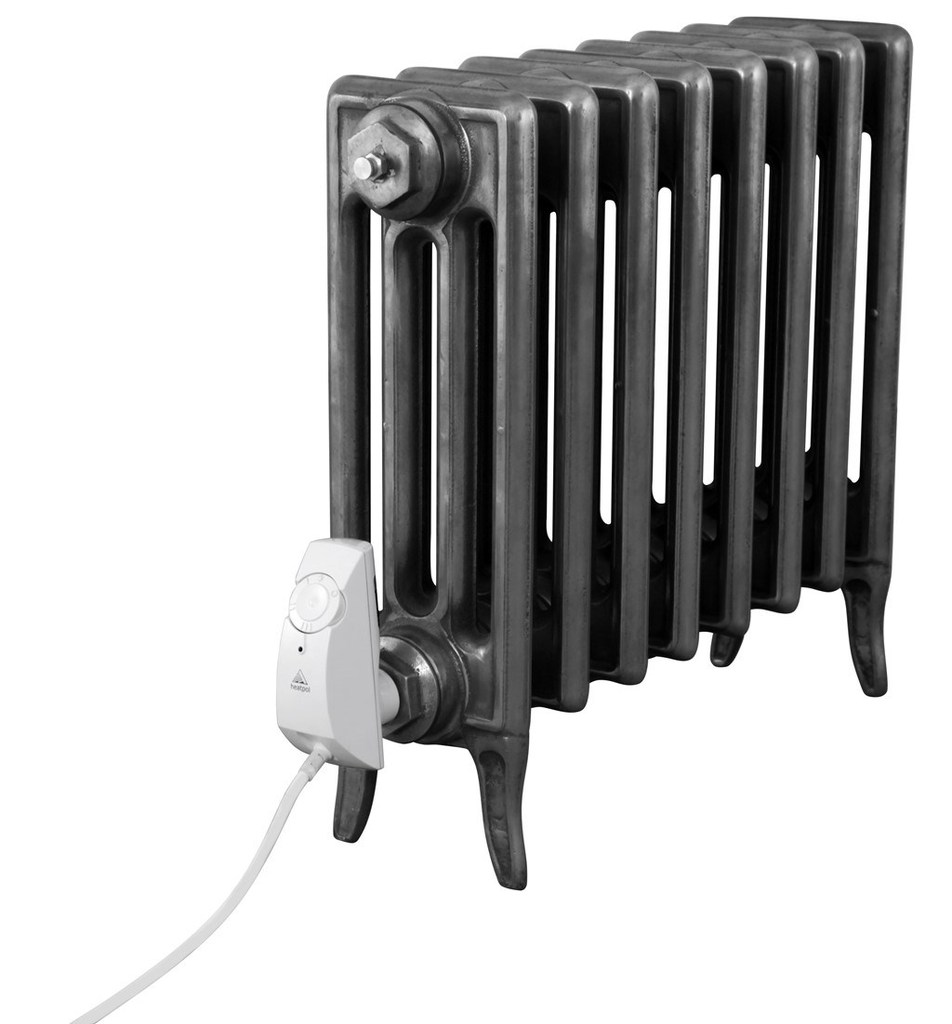 Cast Iron 4 Column Victorian Radiator with electrical elements made by Carron and Sold Worldwide by UKAA