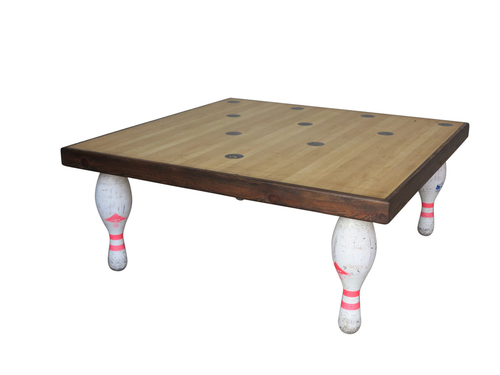 At UKAA we have for sale an original heavy bowling alley table top and skittles legs coffee table. This genuine hard wearing table is easy to wipe clean, the legs can be cut down free of charge to reduce the height. We also have for sale skittles and bowling balls to complete the set