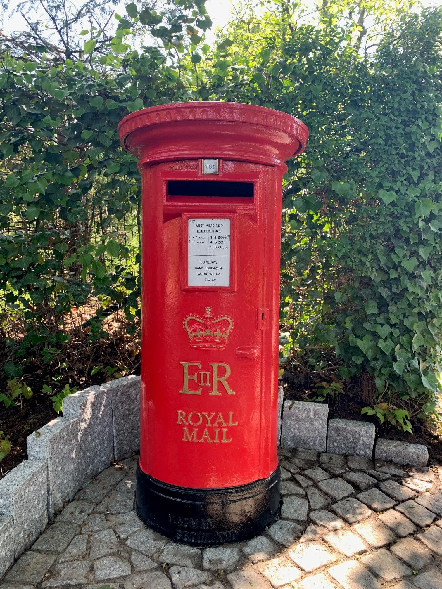 Buy Royal Mail pillar box and post boxes from UKAA. Showing the old red ERII Elizabeth pillar box fitted outside a customers home for their own mail/post